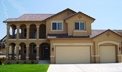 Jackson Creek subdivision, Monument, Colorado, beautiful two-story home with porches up and down, thumb